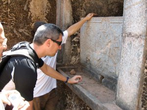 Messianic Jews studying a cistern stone tablet in Old Goa.